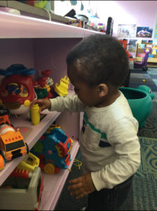 Two Year Old Choosing Toys